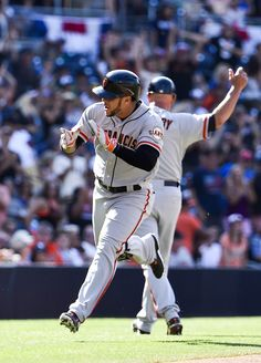 Gregor Blanco #7 of the San Francisco Giants claps as he rounds the bases after hitting a solo home run during the second inning of a baseball game against the San Diego Padres at Petco Park July 5, 2014 in San Diego, California.