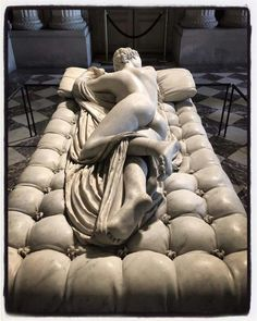 """Sleeping Hermaphroditus"" - an ancient marble sculpture depicting Hermaphroditus life size. In 1620, Gian Lorenzo Bernini (Italy) sculpted the mattress upon which the statue now lies. The sculpture has been described as a good early Imperial Roman copy of a bronze original by the later of the two Hellenistic sculptors named Polycles (working ca.155 BC). Discovered at Santa Maria della Vittoria, Rome, it is now on display at the Louvre."