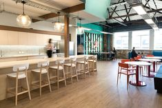 Impact Hub, a network of coworking spaces and social incubators that inspires and connects entrepreneurs from around the globe, recently opened a new Office Interior Design, Office Interiors, Cool Office Space, Office Spaces, Commercial Office Space, Lunch Room, Co Working, Coworking Space, Break Room