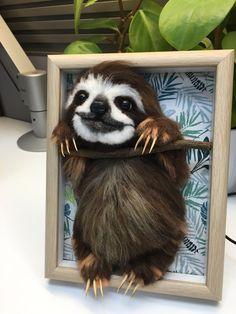 Needle wool felt of a smiling Sloth
