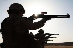 Soldiers shooting the Italian M1014 shotguns