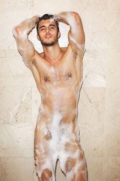 Brunette hunk showering alone