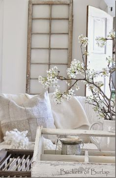 Vintage Country Farmhouse Style, white sofa, Anthropologie throw, hemp patchwork pillows, pear blossoms. Buckets of Burlap home and blog