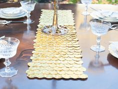 Or use gelt to create a table runner. /  21 Super Cute Ways To Decorate For Hanukkah (via BuzzFeed)