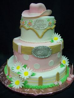 Girly Western Cake - Buttercream iced cake with fondant detailing.  Cowgirl hat is cake with gumpaste brim.