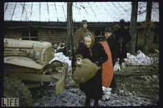December 24, 1944. During the last days of the Battle of the Bulge, American GIs help fleeing local residents load themselves and their belongings onto a truck. There were an estimated 3,000 civilian casualties during the conflict.  (Slate Magazine)