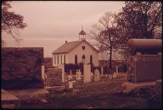 October This cemetery and church form an oasis surrounded by miles of stripped land in southeast Ohio, near Steubenville. At the time this photo was taken, the church had been repainted as a public relations effort by the Hanna Coal Company. Still Picture, Photo Maps, National Archives, Public Relations, Family History, Cemetery, Oasis, Environment, The Unit
