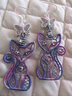 These cute lavender kitties have crystal eyes and hearts and sit under a butterfly bead. They are so light weight and fun