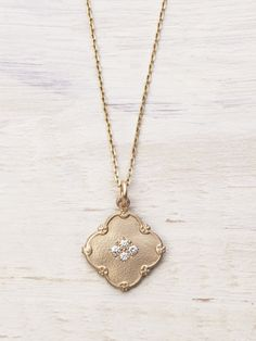 Lucky you found a magic charm necklace! Four perfect sparkling Diamonds glitter with optimistic possibility on your heart's truest desires. This beautiful matte-finished Solid 14K Gold charm necklace