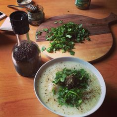 A cauliflower soup with pesto and pepper