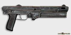 Пистолет-пулемет ТКБ-486 с прикладом, сложенным на ствольную коробку и ствол и с закрепленным под стволом коробчатым магазином - для скрытого ношения