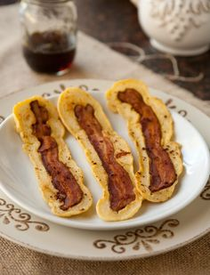 """Bacon Strip Pancakes - these were pretty amazing.  cooked up some bacon in the oven, poured some """"power pancakes"""" batter (from Beachbody's Power 90 recipe book) over each strip on the griddle, cooked like a regular pancake.  Hubby loved it :)"""