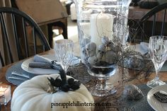 Halloween black and white tablescape.  I love the skulls in the hurricane!