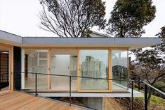 steep-slope-house-with-bookshelf-lined-interior-3-deck.jpg