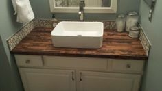 Completed master bath Master bath remodel - painted vanity (Benjamin Moore Soft Chamois), butcher block countertop, vessel sink, mosaic tile backsplash, framed mirror, Benjamin Moore Mt. Saint Anne wall color