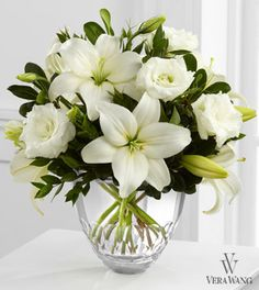 "Vera Wang Arrangement      ""Exquisite"" bouquet is pictured here but they have 3 others that are just a little less lush and less expensive and they are all in that beautiful Vera Wang glass vase! An arrangement for every budget!   The FTD White Elegance™ Bouquet by Vera Wang"
