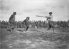 Captain Robert Pearson of the Y.M.C.A. umpiring behind the plate at a baseball match held in the Canadian lines. September, 1917.