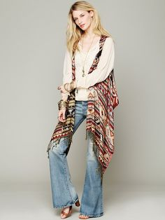 Free People Mojave Reversible Poncho Vest at Free People Clothing Boutique Long sleeve and poncho vest. Cute!
