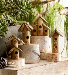 Driftwood birdhouse ornament. Slim branches get driftwood shingle roofs and perches to create a natural birdhouse ornament. Twine loop included for hanging.
