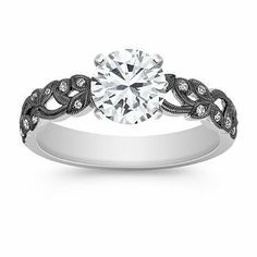 Vintage Diamond Engagement Ring with Black Rhodium. Shown with a round cut diamond. Available with your choice of diamond, ruby or sapphire.
