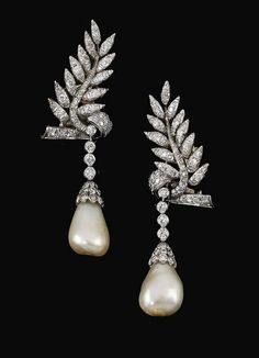 Lot 544 – PAIR OF NATURAL PEARL AND DIAMOND PENDENT EARRINGS  FORMERLY IN THE COLLECTION OF BARONESS DE RENZIS SONNINO 19,000 – 29,000  Each surmount Designed as a leaf set with circular-cut Diamonds, suspending a drop-shaped Natural Pearl from a line of Diamonds, post and butterfly fittings.  FORMERLY IN THE COLLECTION OF BARONESS DE RENZIS SONNINO