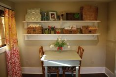 LOVE the curtains!! And the shelves! And the table!