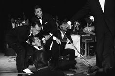 Part of the Rat-Pack humourous routine on stage where Dean starts to sing with the group and in a grand arm motion falls down (seemingly partly drunk); a stunt Dean did over & over again like clock-work and like a pro stuntman.
