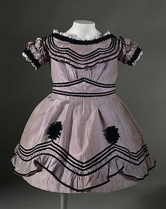 A very cute English child's dress dating to 1864.