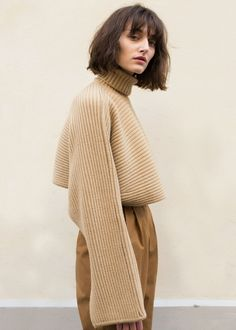 """Cropped, Horizontally Ribbed Sweater w/Elongated Sleeves & Slit Cuffs Color- Camel Brown 85% Wool, 15% Cashmere 13"""" Length, 23"""" Bottom Hem Width Dry Clean Imported"""