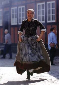 publicity shot from Den Gamle By (The Old Town) in Aarhus, Denmark. A living museum about town life from to
