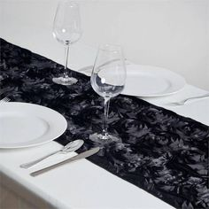 Wonderland Rosette Table Runners - Black |  Add oodles of flair and character in your party with our enticing raised rosette table runner, which is simply breathtaking. The very sight of this floral ecstasy will bring the divine vision of a paradise garden with its whimsical blossoms and luster into your event/celebration. For those special and rare celebrations that need to have an extra doting touch in their ambiance decoration, this top-notch rosette linen is a picture perfect choice. The…