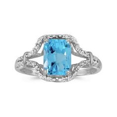 Experience the Striking Beauty of this 14k White Gold Emerald-cut Blue Topaz and Diamond Ring!