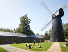 Local architecture studio Squire & Partners has created an elongated, black community centre in a park alongside the Brixton Windmill in London. Community Space, New Community, Community Building, Gable Wall, Grain Store, Timber Screens, Old Windmills, Roof Structure, Listed Building