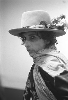 Bob Dylan...lol..who say's a fella can't be boho and chic as well..look at those flowers in his very groovy hat!! Like a Rolling Stone!!