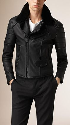 Burberry Black Shearling Topcollar Biker Jacket - A soft biker jacket with quilted sleeve panels. The design features a detachable topcollar in shearling. Zip pockets, reinforced seams and side adjusters reference classic biker designs.