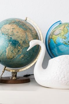 Globes and swans at @annasterntaler's colourful home in Berlin.