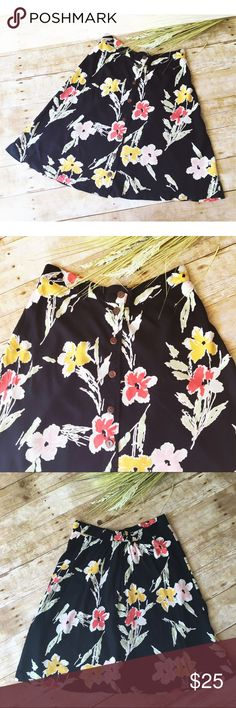 Urban Outfitters Black Kimchi Blue Floral Shirt Cute black floral Urban Outfitters skirt Kimchi Blue. Features front button closure with distressed button, partial elastic waist & Cute & colorful floral print. Preloved & in good condition! Urban Outfitters Skirts