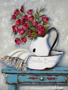Stella Bruwer white enamel pitcher and basin with white fringe towel red flowers shabby blue table with drawer has small red flowers on drawer front