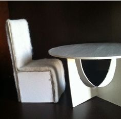 First Stage Of Miniature Dollhouse Dining Room Table With Parson Chairs.  Table Is Cardboard.