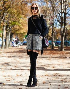 Thanks to her structured shorts and demure top, over-the-knee boots look ladylike instead of Pretty Woman-esque.