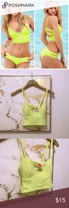 Victoria's Secret Strappy Bikini Top Victoria's Secret Neon Green/Yellow Strappy Cutout Bikini Top - Size S - Only worn 1x; like new - Sold out style - This listing is for the top only!  Feel free to ask any questions! No trades!  Victoria's Secret Swim Bikinis
