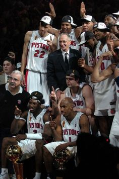 The Pistons play around in a champions group photo after the victory as the Detroit Pistons take on the Los Angeles Lakers in Game 5 of NBA Finals at the Palace of Auburn Hills, Mich., on June 15, 2004.    (The Detroit News/Robin Buckson)
