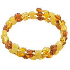Bracelet en ambre naturel multicouleurstyle accordeon sur 3 tours avec perle d'ambre en forme d'olive. Longueur pierre: 0.5 cm Diamètre approximatif: 5.8 cm Circonférence: 18 cm (ajustable sur élastique) Poids approximatif: 7 - 9 grammes
