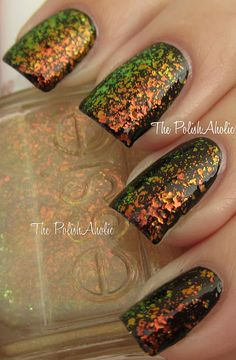 *Essie - Shine of the Times (LuxeEffects Glitter Topcoat Collection Holiday 2011) / ThePolishaholic [Layered over Black]