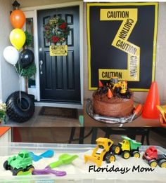 construction birthday decorations-like the tire with balloons, and the number out of caution tape