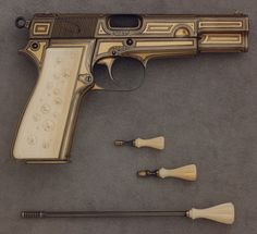 Lock, Stock, and History — Gold Inlaid Browning Model 1935 with ivory grips,...