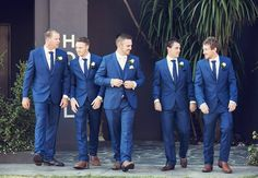 Brendan + Laura's Wedding Sand, Sun, Love, and Happiness Brendan and the boys looking dapper in their Zenetti blue lounge suits. Brendan wore the ZSU042 with the matching vest to differentiate himself from his groomsmen who also wore the blue two button single breasted suit. The ZSU042 is available at your local Ferrari Formalwear & Bridal store. Read more on the Ferrari Formalwear & Bridal Blog.
