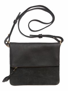 Hand-crafted in Kenya, this unique leather foldover crossbody bag has multiple pockets and features sections of contrasting suede. The ziptop compartment works great for keeping your essentials secure.  It snaps closed over an easy access front pocket, with additional pocket in the rear.