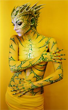 Tauart. Brings us these bold ethereally photographs of models painted like creatures in our world.