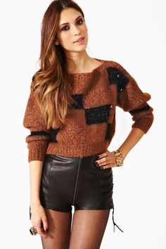 Love the color and design of this sweater!